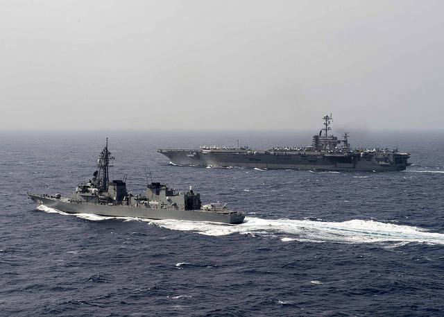 USS John C. Stennis transits JS Samidare. US Navy photo