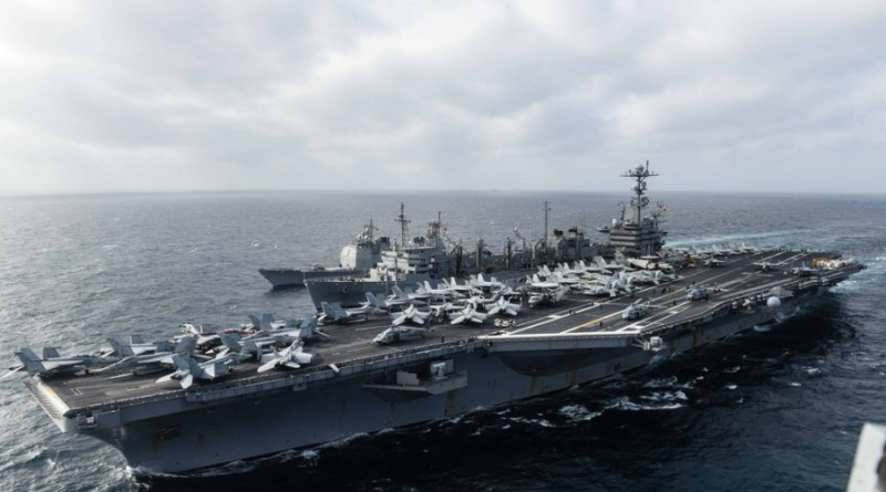 CVN 74 participates in a replenishment at sea with USNS Rainier (T-AOE 7) and CG 53 in West Philippine Sea, March 4.