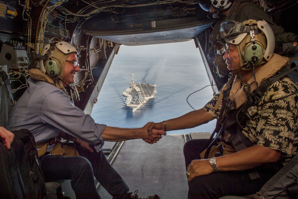US Secretary of Defense Ash Carter (left) and Secretary of National Defense Voltaire Gazmin (right) shake hands on a Marine Corps V-22 Osprey as they depart the USS Stennis after touring the aircraft carrier as it sails the West Philippine Sea April 15, 2016. US photo