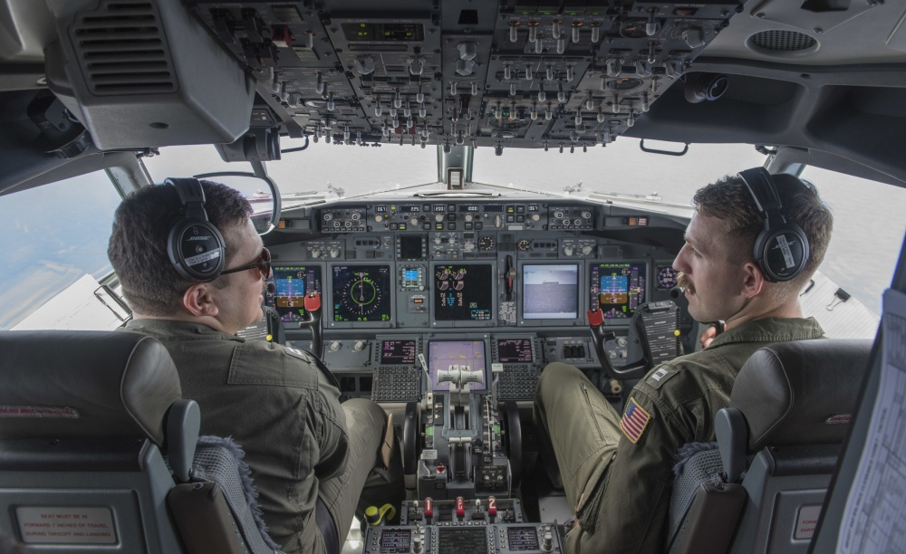 US Navy Lieutenants Eric Bowers and Eran Wilson discuss flight operations while in flight aboard a P-8 Poseidon maritime patrol craft above Subic, June 8. US Navy photo