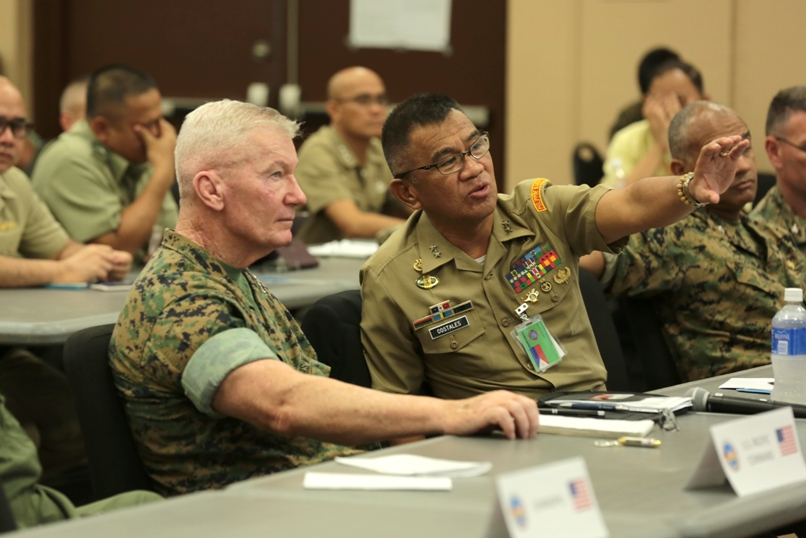 Commander of U.S. Marine Corps Forces, Pacific, Lt. Gen. John A. Toolan, listens as Major Gen. Andres Costales, Armed Forces of the Philippines Deputy Chief of Staff for Education, explains concepts for Balikatan 2017. US Marines photo