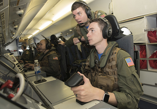 US Naval personnel aboard a P-8 Poseidon maritime patrol craft communicate with Armed Forces of the Philippines aircraft, June 8. US Navy photo