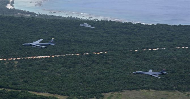 A U.S. Air Force B-52 Stratofortress, B-1 Lancer and B-2 Spirit fly over Guam after launching from Andersen Air Force Base, Guam, for an integrated bomber operation Aug.17, 2016. US Air Force photo