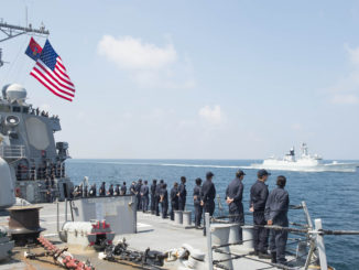 Sailors aboard the guided-missile destroyer USS Benfold (DDG 65) man the rails before the ship breaks away from the People's Liberation Army (Navy) Jiangkai II class frigate Daqing (FFG 576) during a Code for Unplanned Encounters at Sea (CUES) exercise.  US Navy photo