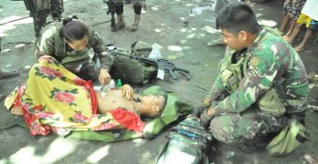 Government troops provides assistance to wounded NPA terrorist